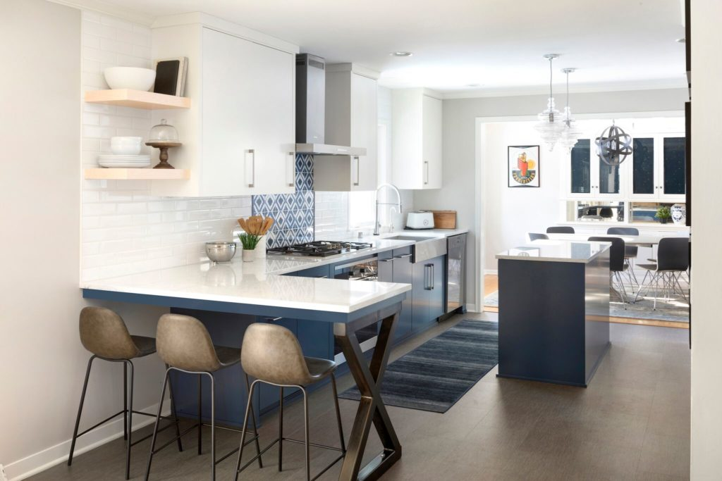 Kitchen with an island and stools.