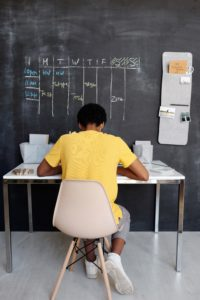 Kid working on homework in their study area.