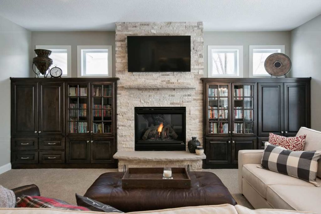 Fireplace with bookcases.